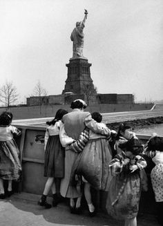 Immigrants with Statue of Liberty